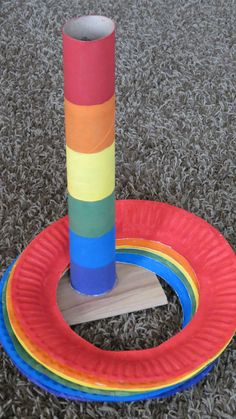 Ring Toss party game- paper towel roll, paper plates, a little paint, and a wood floor sample.