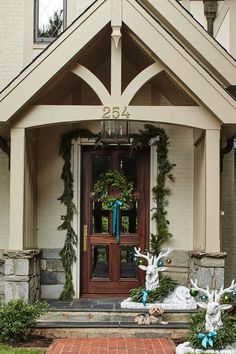 This Cozy Spartanburg Tudor Is All Dressed Up For Christmas - Southern Living. Love the christmas decor for the front porch Front Porch Addition, Front Porch Design, Christmas Porch, Outdoor Christmas, Christmas Decor, Primitive Christmas, Country Christmas, Christmas Christmas, Holiday Decor