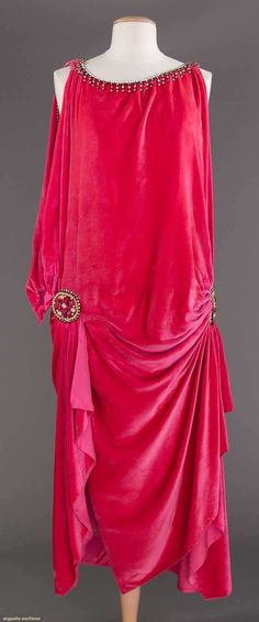 "ROSE VELVET EVENING GOWN, 1918 October 25, 2017 New York City Sleeveless, scoop neckline w/ rhinestone trim, two jewelled elements at side H w/ soft folds beneath, B to 42"", H to 40"", L 52"", (on right side open seam & missing stones on left side opening, slip straps worn & underarm stains on pink charmeuse slip) very good."