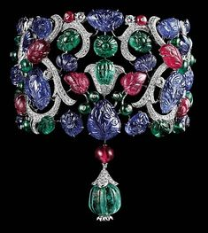 Cartier.  Carved emeralds, rubies and sapphires and brilliants set in platinum.    Lol....this looks like a funky lamp to me.