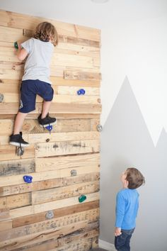 Shared Boy's Room Inspiration + DIY Pallet Climbing Wall! Such a fun update to a simple bedroom.