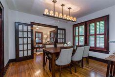 Hardwood floors, intriguing overhead lights, and dark wood plantation shutters 1205 Bickler Rd, Austin, TX 78704