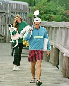 Carolyn & JFK Jr.: love how casual they look in this shot...especially with her dog slung under her arm