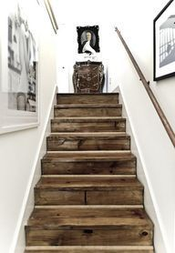 This wooden staircase not only stands out among the white walls, but also adds a touch of whimsy to a modernist home.