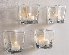 Glass candle holders glued on wall