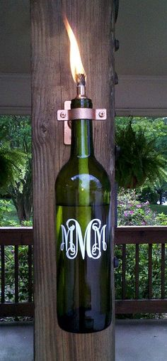 "The monogrammed lantern is made from a recycled wine bottle. This lantern will light your way on any dark night or get rid of those pesky bugs when burning citronella. The lantern makes a great gift for the ""green"" person in your family, or for anyone who likes to spend a little time outdoors."