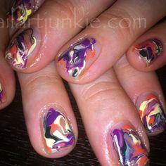 Marbled Nails done with MAC nail lacquers in Fiestaware , near Beth experience, into the dark purple and deep sea  More into on nailartjunkie.com