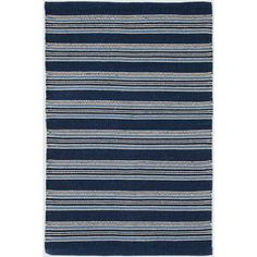 Test drive this rug in your space.Order a swatch by adding it to your cart.Based on an antique textile found at Brimfield, this indoor/outdoor rug has a rich mix of navy, indigo, and sky stripes.Made of 100% PET, a polyester fiber made from recycled plastic bottles.