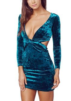 Brunette in a blue velvet knotted bodycon dress