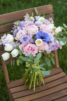 Bridal Bouquet by Emlily Floral. White tulips, pink garden roses, blue anemone. http://emlilyfloral.com/. Something blue.