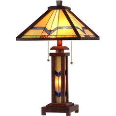 Handcrafted with over 60 hand-cut pieces of art glass, this beautiful stained glass table lamp is double lit between the base and the shade. This elegant design features geometric shapes in rich colors to illuminate your home exquisitely.