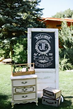 chalkboard wedding welcome sign on vintage door