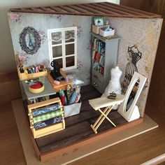 I made a mini craft/sewing room. I absolutely love the wallpaper for this one! Mini Craft, Mini Things, Diy Dollhouse, Vintage Looks, My Favorite Things, Shelves, Doll Houses, Sewing, Wallpaper