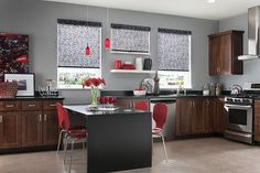 Roller blinds, roller solar screens, roller shades, roller blinds, sunshades - versatile window treatment ideas that are great for sun control on the interior and exterior of your home. Blackout roller shades to solar shades with sun screen fabric that allow you to see the outside even when they are down. This example of gray roller blinds from Graber in a kitchen show fabric that light passes through, but no UV rays. Solar fabric will allow some UV rays.