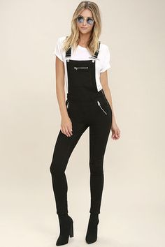 The Cheap Monday Zip Black Denim High-Waisted Overalls are pretty neat-o, and by neat-o we mean, you need them now! Stretchy denim constructs these classic overalls with a high-waisted fit and exposed zipper accents. Adjustable straps secure atop the bib (with zipper pocket), while belt loops round the waist. Four-pocket cut and skinny pant legs.