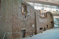 Some of the Minoan era houses at Akrotiri unearthed from the volcanic ash. The West House where the Fleet Fresco was discovered is on the far end of the row.