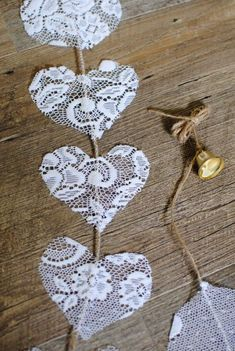 Items similar to Vertical lace hearts on a jute cord, with a gold coloured bell. Suitable to decorate wedding and party venues. on Etsy Vertical lace hearts on a jute cord, with a gold coloured bell. Suitable to decorate wedding and party venues. Wedding Crafts, Diy Wedding, Rustic Wedding, Wedding Lace, Wedding Things, Wedding Bells, Lace Wedding Decorations, Wedding Reception, Wedding Bunting