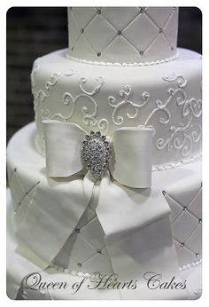 4-tier fondant covered wedding cake.  Gumpaste bow.