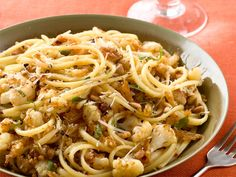 Cauliflower-Onion Linguine from FoodNetwork.com  -  This veggie-packed, flavorful pasta makes a satisfying meal.  Read more at: http://www.foodnetwork.com/quick-and-easy/one-dish-dinners/pictures/index.html?oc=linkback