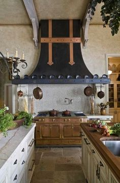 greysmycolor:    georgianadesign:    Chateau Lyon in North Carolina.     Definitely in my top five stove hoods