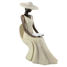 """Into the Word"", a figurine from our new Virtuous Woman Figurine Collection. The Lady in White Series. Beautiful bronze toned resin figurines."