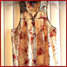 Love Squared Floral Print Blouse Gently worn twice, Excellent condition.  Sleeveless button front blouse with opening at upper back. 100% cotton. Made in India Love Squared Tops Blouses