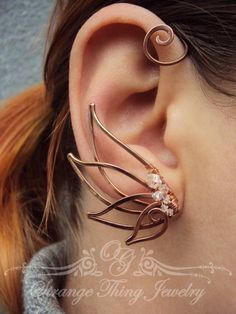 Pair of copper ear cuffs The Swan Song by StrangeThingJewelry on Etsy https://www.etsy.com/listing/220125643/pair-of-copper-ear-cuffs-the-swan-song