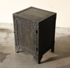 All steel industrial style end table, side table, cabinet. Aged steel paint, patina with rivets.