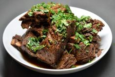 Nom Nom Paleo's Slow Cooker Korean Short Ribs Recipe - uses pear for sweetness and coconut amigos which would also add some sweetness without sugar.