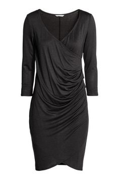 MAMA Draped nursing dress: Short, fitted jersey dress with a V-neck and a practical inner top for easier nursing access. Sewn-in wrapover, draped front with a pleat in one side and 3/4-length sleeves.