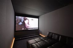 Compact Home Cinema room with bespoke fabric walls and integrated lighting