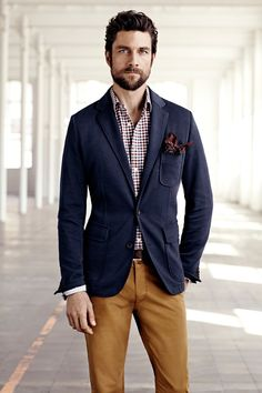 navy blazer, black and red checkered shirt, white and maroon patterned pocket square, brown belt, light brown trousers