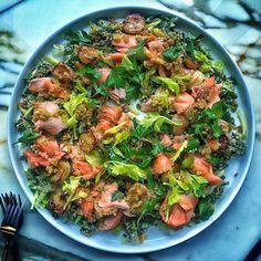 """This is my idea of """"health food"""". Simple roasted salmon paired with turnips, celery, and bulgur. Packed full of flavor, lots of good fats, and nicely balanced with lemon for tang, raisins for sweetness, and parsley for brightness. I snapped this shot right after I cooked it in the BA Test Kitchen. Head to the link in the bio to grab the recipe. - @nappleman"""