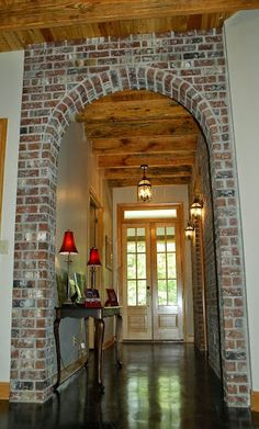 I like brick and wood elements together in a house. I like brick and wood elements together in a house. Future House, My House, Brick Archway, Wood Arch, Brick And Wood, Tall Ceilings, Wood Ceilings, My Dream Home, Home Remodeling