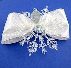 Beautiful Snowflake Angel | This unique angel is made using some unexpected materials.