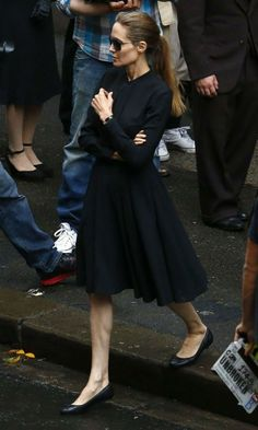 Angelina in tailored, black dress