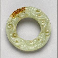 A small yellow jade bi disc