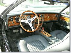 Interior of a 1973 Stutz Blackhawk. The production Blackhawk used Pontiac Grand Prix hardware and Pontiac's 7.5 L (455 in³) V8 engine. Output from the specially tuned engine was 425 hp (317 kW) and 420 ft·lbf (570 N·m). A GM TH400 automatic transmission was used, allowing the 5000 lb (2300 kg) car to accelerate to 60 mph (97 km/h) in 8.4 seconds with a 130 mph (210 km/h) top speed. Fuel economy was just 8 miles per gallon (30 L/100 km). Later Blackhawks used Pontiac's 403 and 350