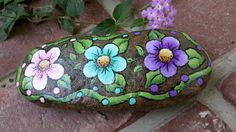 Painted rock garden rock with flowers and polka by MyPaintedSwan