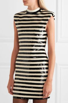 *as a top* Saint Laurent Striped sequined satin mini dress $3,990 Black and off-white sequined satin Concealed zip fastening along back 51% viscose, 22% polyester, 21% polyamide, 6% elastane; embroidery: 100% polyester; lining: 65% acetate, 35% polyamide  Dry clean Made in Italy