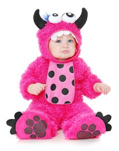 Monster Madness Baby Costume at Spirit Halloween - Watch out for your little one! She'll be up to no good wearing this Monster Madness Baby Costume. Hot pink plush and fuzzy long sleeved jumpsuit has polka dot belly, paw print footsies and hilariously adorable headpiece with fake teeth, googly eyes, curled horns and blue fuzzy eyelashes. Make this hot pink monster yours for $34.99.