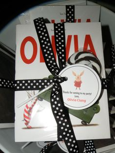 Olivia the Pig Birthday Favors -- book and swirly lolli
