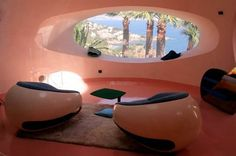 Lounge area with 2 seats at the palais bulles, palace of bubbles Pierre Cardin house by antti lovag in Cannes