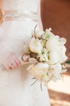 ClassicElegance, Peony Bouquet with Cameo Charm | On SMP: http://www.StyleMePretty.com/southwest-weddings/2013/01/22/houston-wedding-from-kelly-hornberger-photography/  Kelly Hornberger Photography | Bella Flora Designs