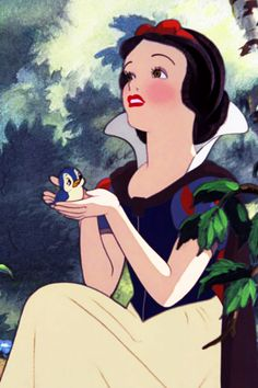 Disney's Snow White with blue bird, beautiful colors, they used real blush on her cheeks