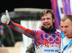 DAY 9:  Alexander Tretiakov of Russia celebrates winning gold after his run during the Men's Skeleton