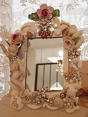 This type of thing can be done to a gold picture frame with a hot glue gun and some bling and pearls and cherubs and ribbon even