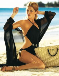 A Gucci black swimsuit look… a prudent seaside holiday must have. Pinned already but this shot is gorgeous.