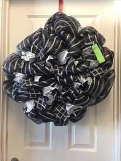 Black and silver wreath now available on https://m.facebook.com/INTOCHRISTMAS/