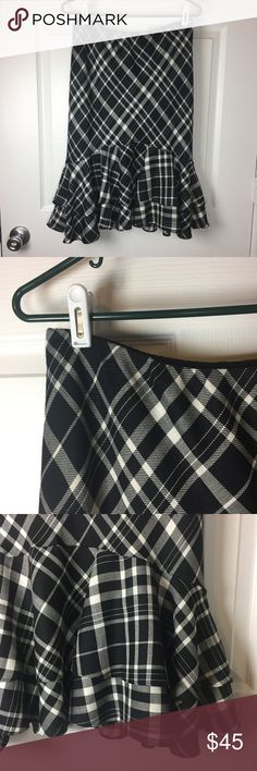 "Lauren Ralph Lauren black white plaid skirt XS Gently used. Gorgeous black and white plaid polyester and rayon blend shell. Slip on design with elastic waist. Ruffle along bottom. 14.5"" across waist. 26"" long. Lauren Ralph Lauren Skirts"